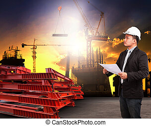 engineering man working in building construction site and readin