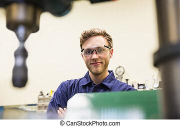Engineering student smiling at camera