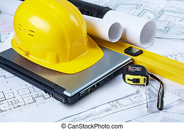 Engineering tools - Image of yellow helmet over laptop with...