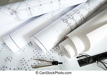 Engineering work - Close-up of blueprints with sketches of ...