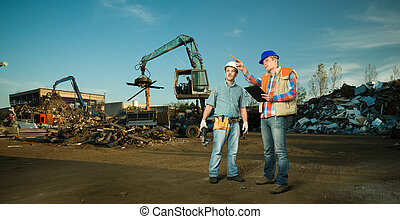 engineers at recycling center - two caucasian engineers...
