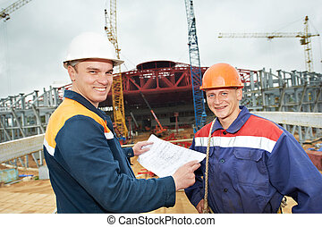 Engineers builders at construction site