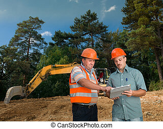 engineers discussing on construction site