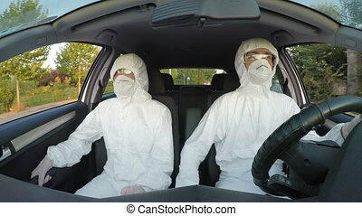 Engineers in hazmat suits driving to their rescue mission