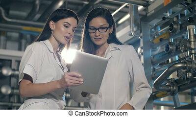 Engineers in mechanical factory working - Team of...