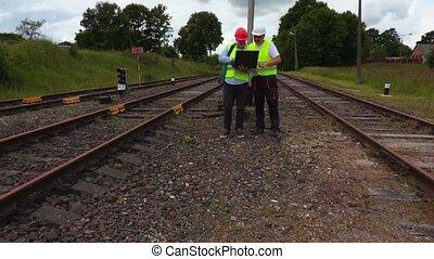 Engineers inspecting railway