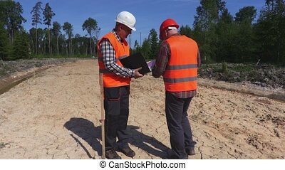 Engineers on new road with documentation