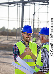 Engineers shaking hands on construction site