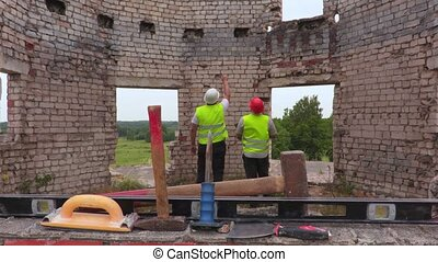 Engineers talking in unfinished building