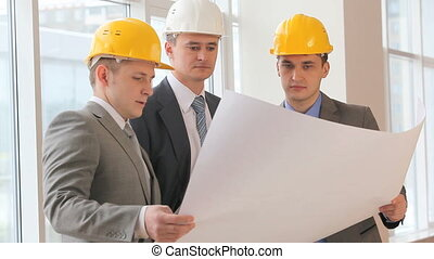 Three architects working together