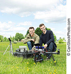 Engineers With Laptop And Digital Tablet By UAV