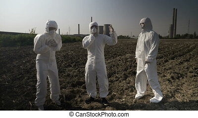 Engineers workers dressing protective hazmat clothes...