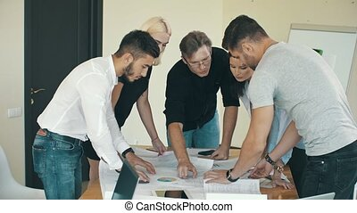 Engineers working in office together