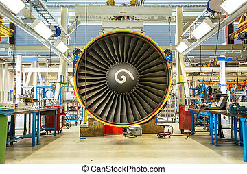 Engine's maintenance in huge industrial hall