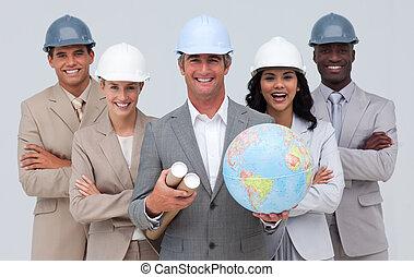 Enginner team holding a terrestrial globe