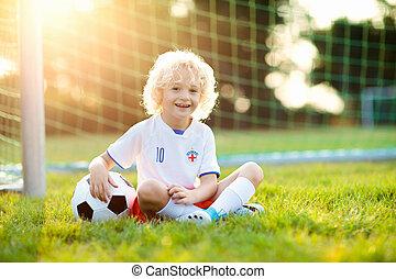 England football fan kids. Children play soccer.