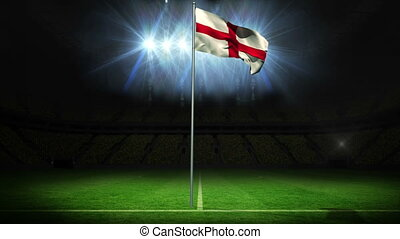 England national flag waving on flagpole against football ...