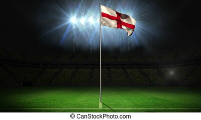 England national flag waving on flagpole on football pitch ...