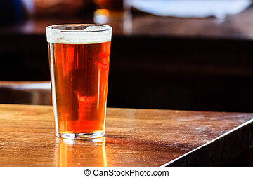 English ale on a table - An english ale on a wooden table in...