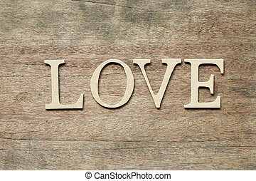 English alphabet in word love on wood background