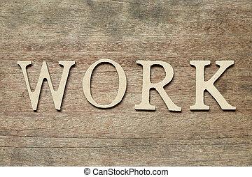 English alphabet in word work on wood background