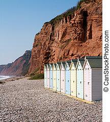 Beach huts and sandstone cliffs Budleigh Salterton Devon