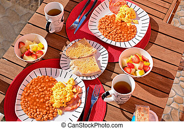 English breakfast for two on a balcony