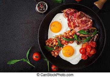 English breakfast - fried egg, beans, tomatoes, mushrooms,...