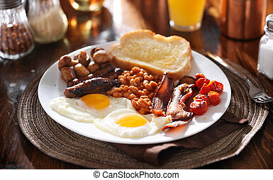 english breakfast with eggs, tomatoes, mushrooms, bacon, ...