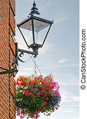 English, British street lamp and hanging basket of flowers