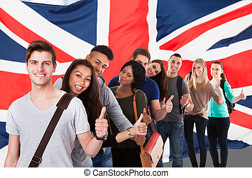English Classes - Group Of Happy Multi Ethnic Students...