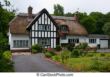 English Country Cottage - Exterior of a traditional thatched...