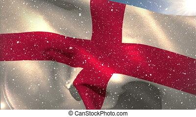 English flag waving under the snowfall