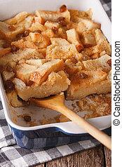 English food: bread pudding close up in baking dish....