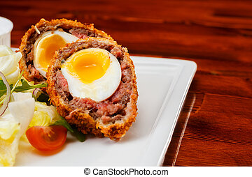 English food, Scotch eggs served with lettuce, toatoes and ...