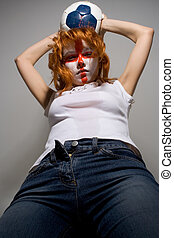 attack - english football makeup girl holding worn soccer...