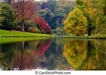 English Garden - English garden in fall with reflections in...