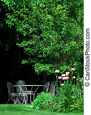 English Garden - English garden with table and chairs, in...