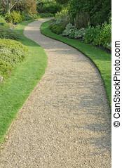 English garden gravel path in autumn