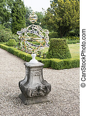 english garden with big sundial