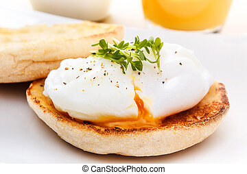 english muffin with egg - poached egg on english muffin with...