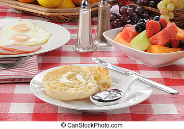 English muffin with ham and egg breakfast