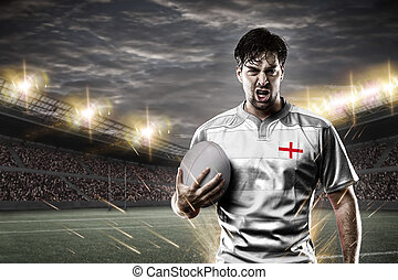 English rugby player, wearing a white unifrme in a stadium.