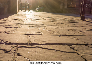 English street surface in evening sun light