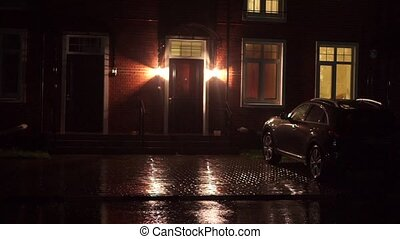 English-style house and parked car at rainy night