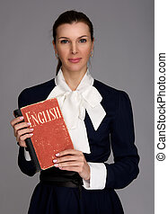 English teacher holding a textbook