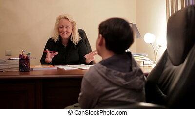 English teacher teaches the schoolboy. - Middle-aged english...