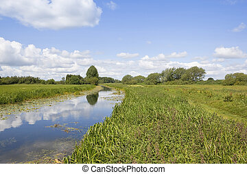 english waterway - an english landscape with a view along a...