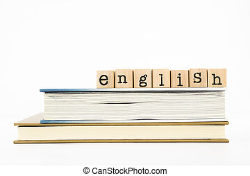 closeup english wording stack on books. english for foreigner, tutorial and learning concept and idea.
