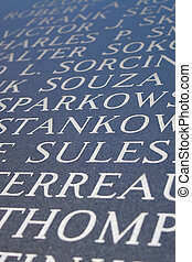 Engraved Letters - Abstract closeup of engraved names on the...